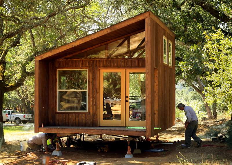 Wood Small Cabin Front at Spring Lake, Foxlin Architects